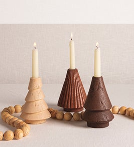 Image of three carved wooden tree candle holders