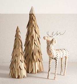 Image of kantha deer and rustic wooden tree mantel decorations