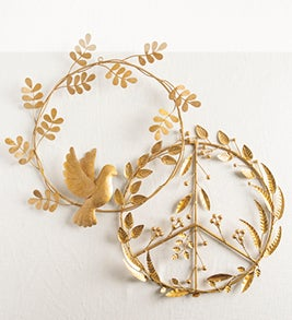 Image of two gold metal wreaths of leaves and berries